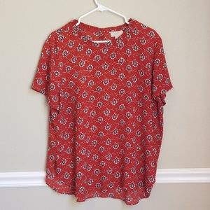 Red patterned blouse